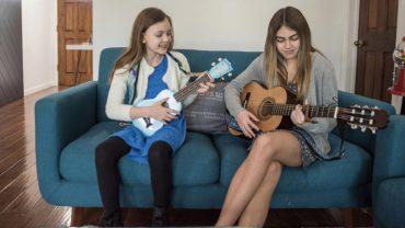 iLEAD Online learners play guitar